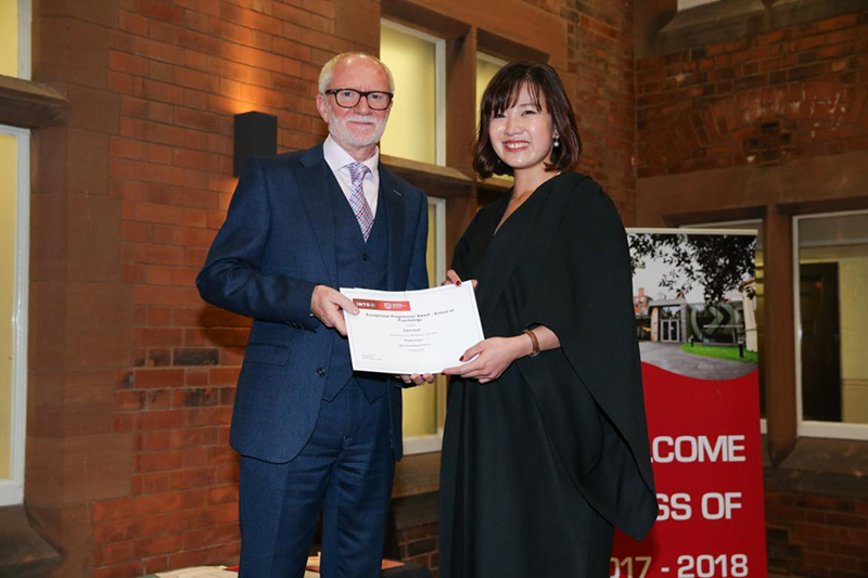 Ewen Chan receiving certificate