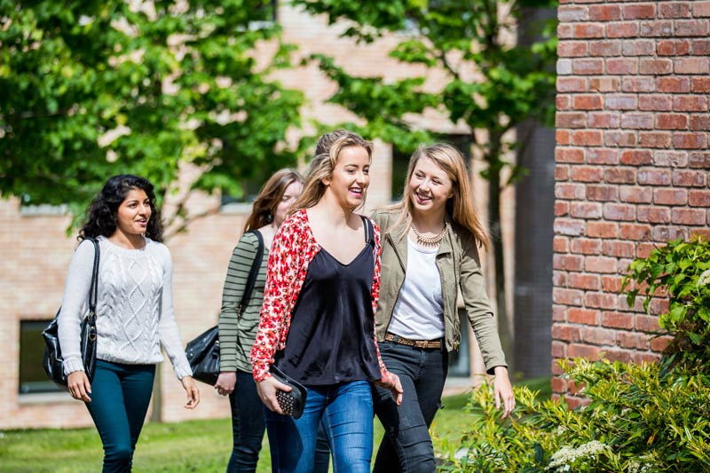 group of female students walking through Elm's village