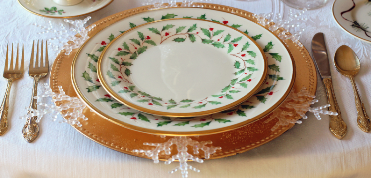 Christmas dinner table setting with china plates