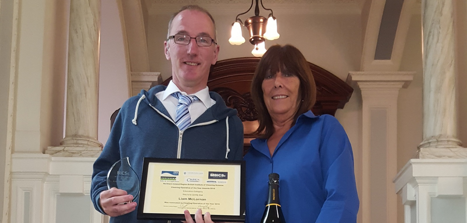 Queens Cleaner wins British Institute of Cleaning Science Award. Liam McLarnon(left) with his supervisor, Carol Clarke (right).