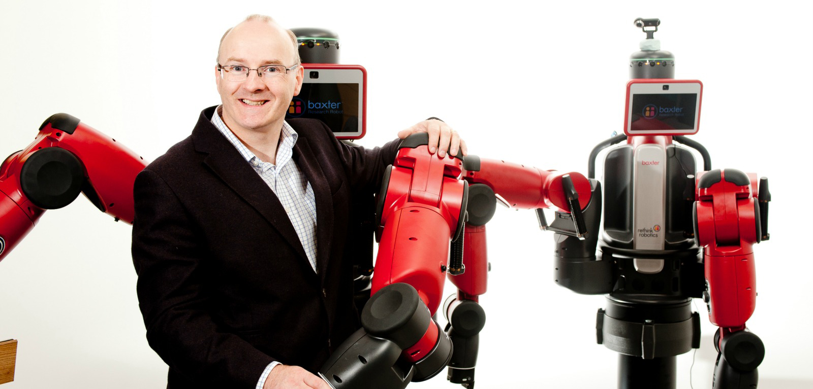 Prof. S.McL with two baxter robots