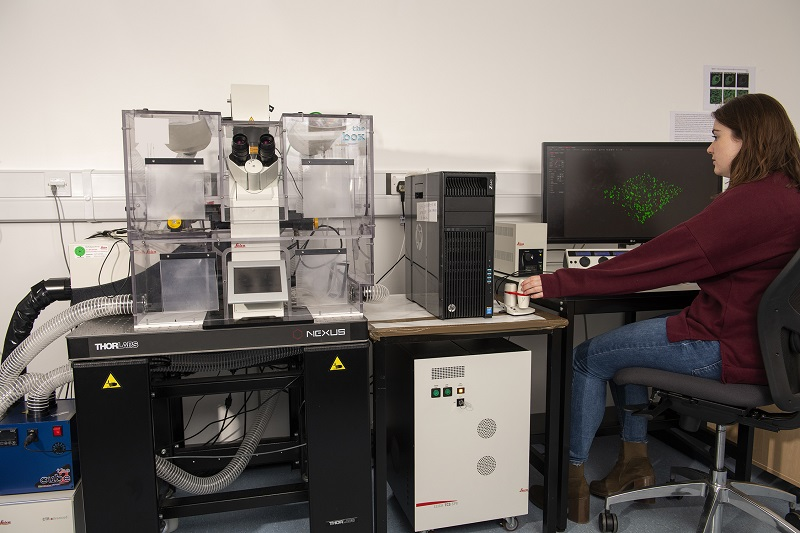 Student using Advanced Imaging microscope