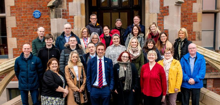 Staff and partners group celebrating 5 years of QUB Inclusive Employment