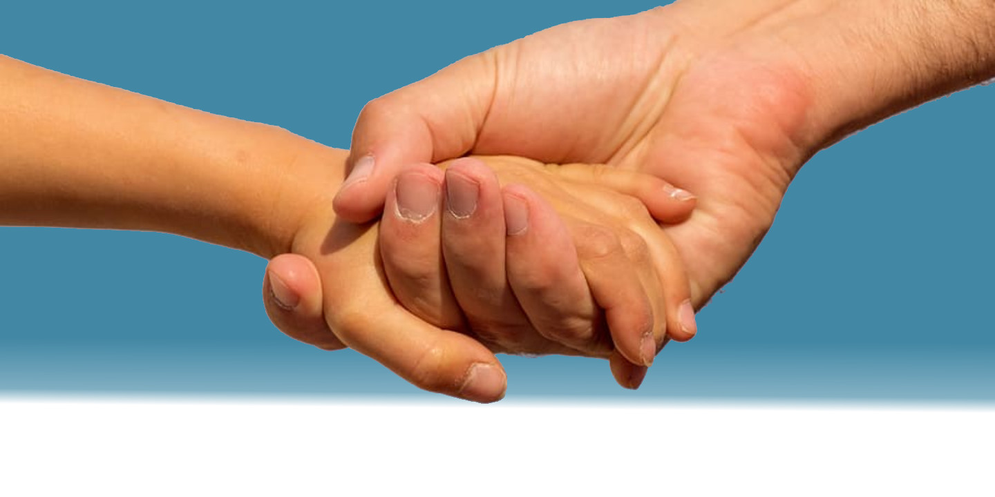 Father and child's hands, blue background